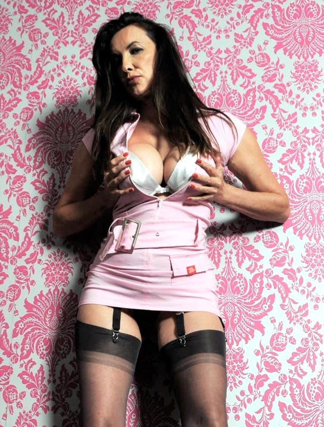 Nylon Jane wearing a pink outfit and nylons