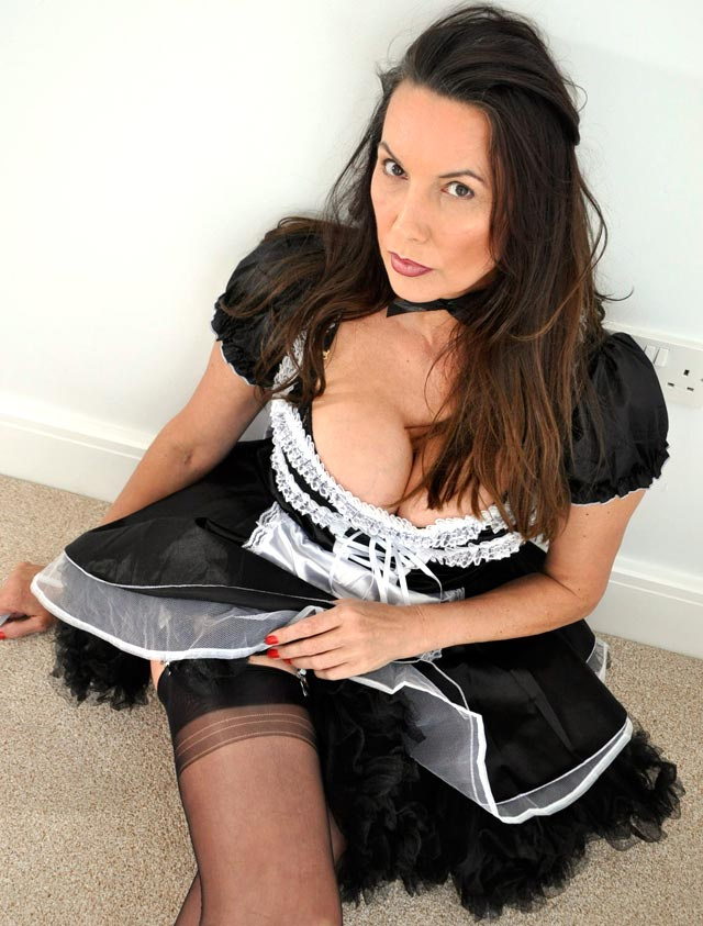Nylon Jane in maid outfit and stockings