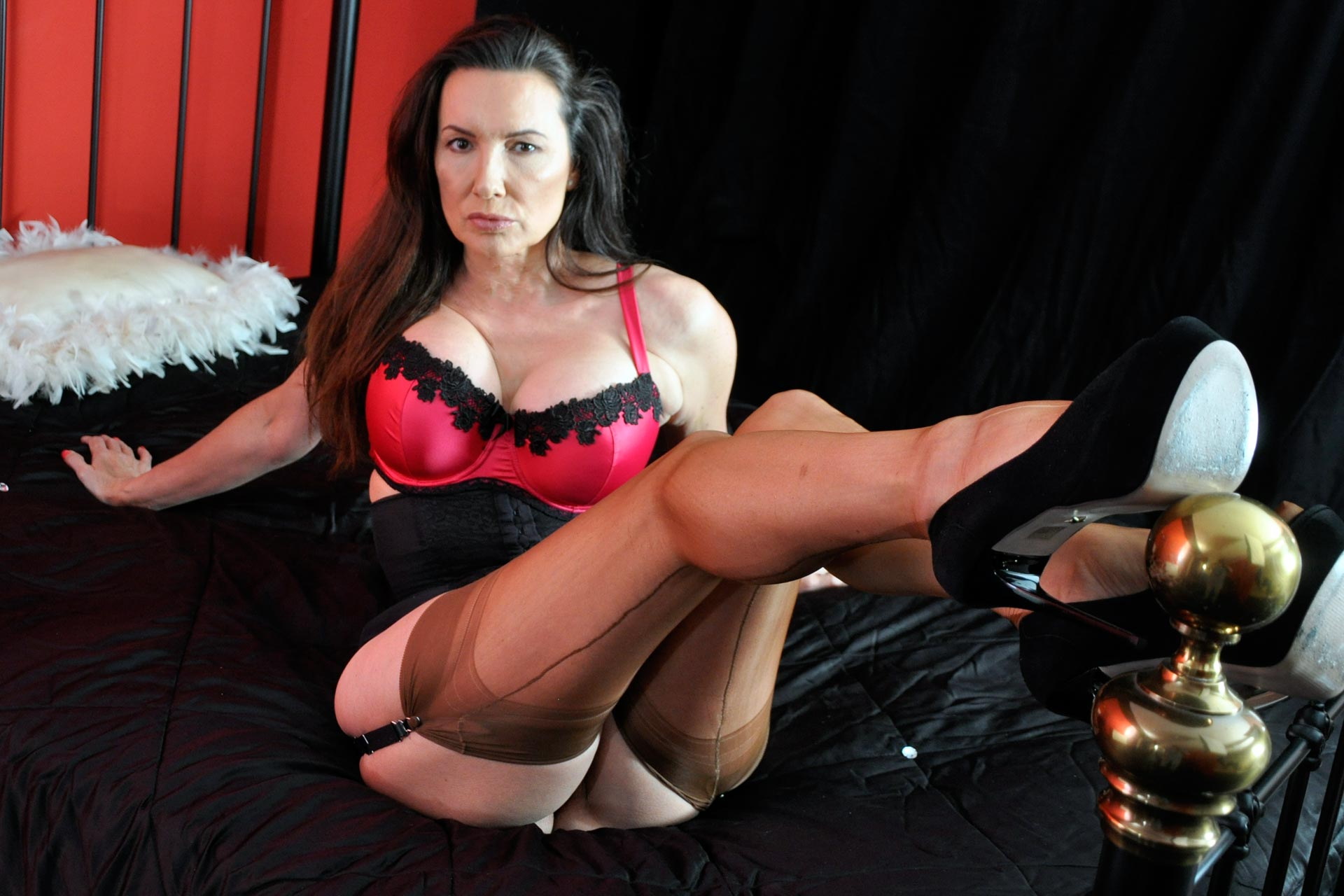 Nylon Jane laying on her bed with nylon stockings