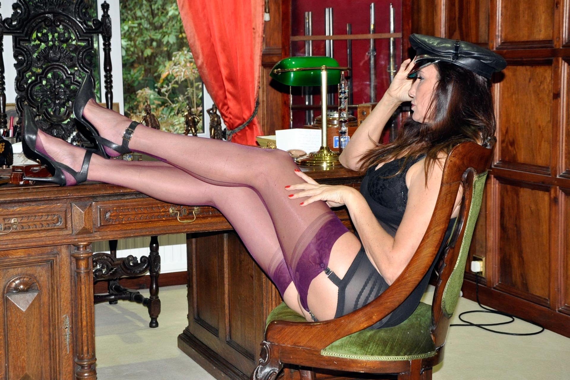 Nylon Jane shows off purple stockings